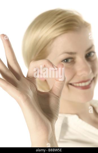 Girl Making OK Hand Gesture - Stock Image
