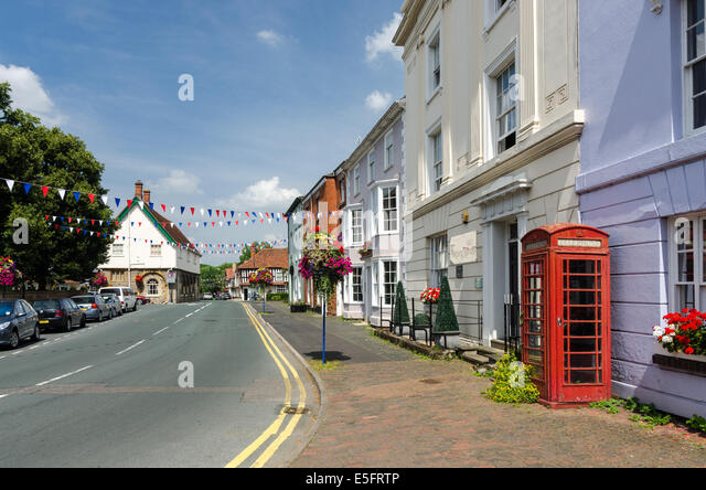 Church Street in the Warwickshire town of Alcester with the old twon hall on the left and Georgian houses on the - Stock Image
