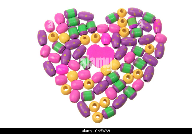 Beads Arranged in Shape of Love Heart - Stock Image