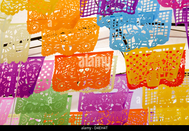 Brightly colored cut paper flags with Day of the Dead designs in Oaxaca, Mexico. - Stock Image