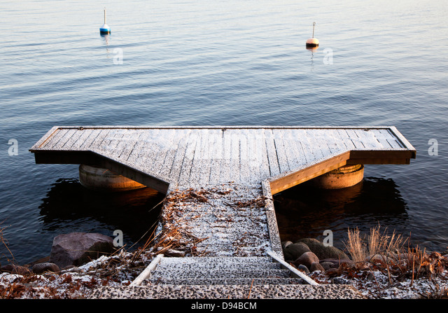 Jetty covered with snow - Stock-Bilder