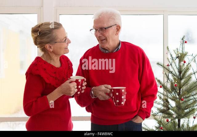 Senior couple having coffee during Christmas - Stock Image
