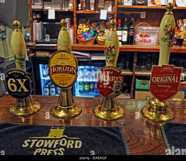 English traditional ale hand drawn pumps on a bar in Wiltshire, South West England - Stock Image