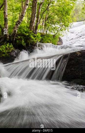 Slow shutter speed to create silky waterfall, Hellemoboten, Norway, Scandinavia, Europe - Stock Image