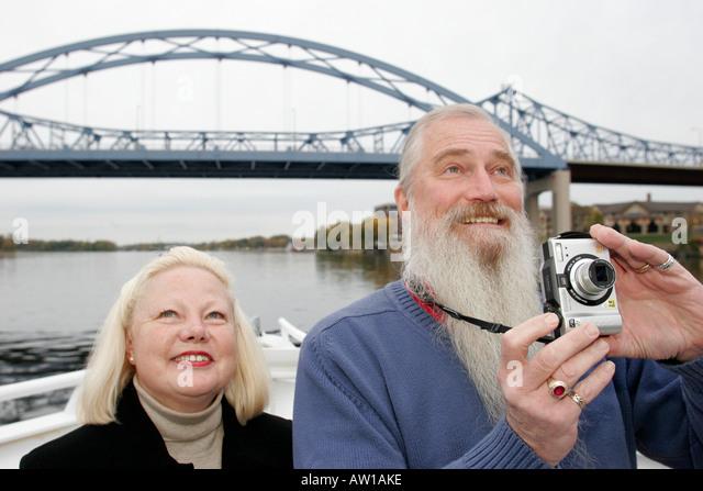 Wisconsin La Crosse Mississippi River Island Girl Yacht Cruise Cass Street Bridge tour boat man woman camera - Stock Image
