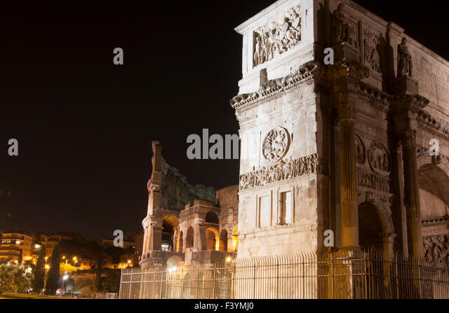 Colosseum and Arch of Constantine at night - Stock Image