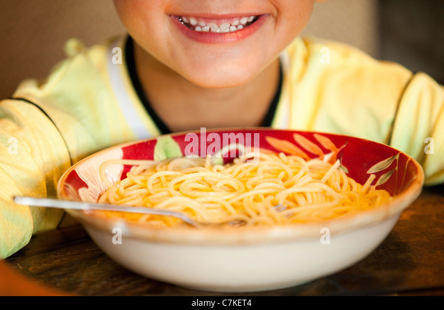 Boy and Spaghetti Bowl - Stock Image
