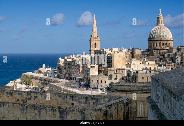 The walls and spires of Valletta, Malta, point across the Mediterranean sea - Stock Image