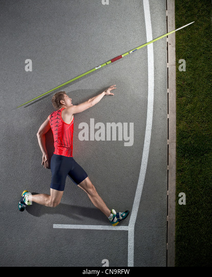 Javelin thrower laying on track - Stock Image