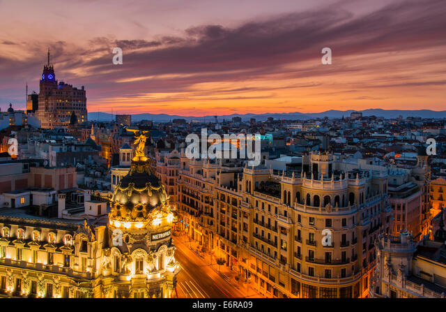 Skyline with Metropolis building and Gran Via street at sunset, Madrid, Comunidad de Madrid, Spain - Stock Image
