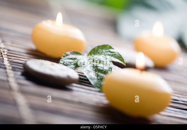 Close up of yellow candles with shallow focus - Stock Image