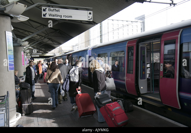 UK, England, Manchester, Manchester Airport Railway Station, passengers, luggage, train, - Stock Image