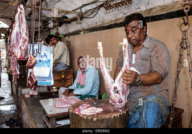 Mumbai India Asian Lower Parel Sunday Market meat vendor shopping selling sale butcher working man - Stock Image
