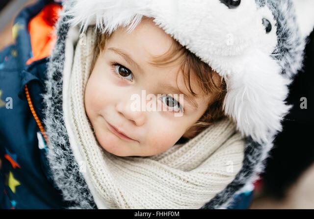 Portrait of little boy wearing warm clothing - Stock Image