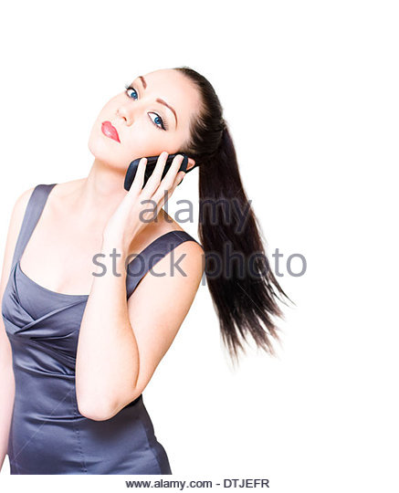 Sexy And Stylish Young Business Woman Rushing Around At Fast Pace While On A Business Communication Cell Phone Conversation - Stock Image