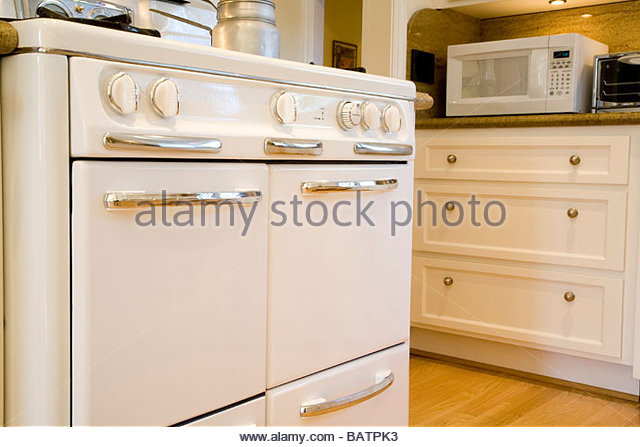Old-Fashioned Oven in Country Style Kitchen - Stock Image