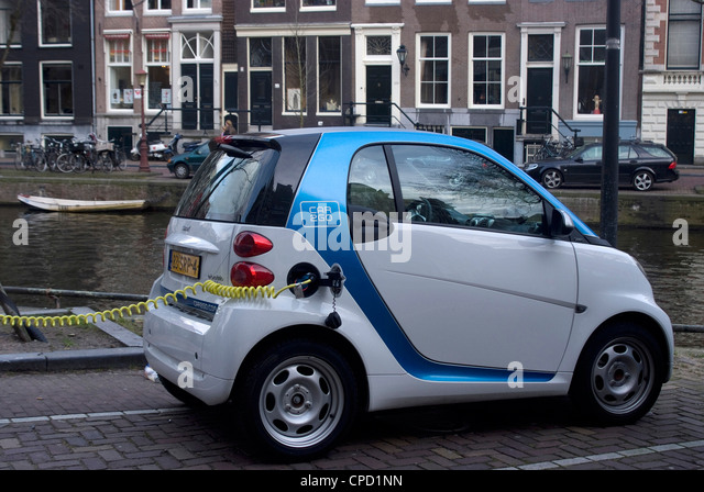 Charging an electric car, Amsterdam, Netherlands, Europe - Stock Image