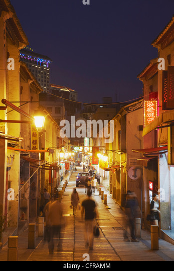 People walking along Rua da Felicidade at dusk, Macau, China, Asia - Stock Image