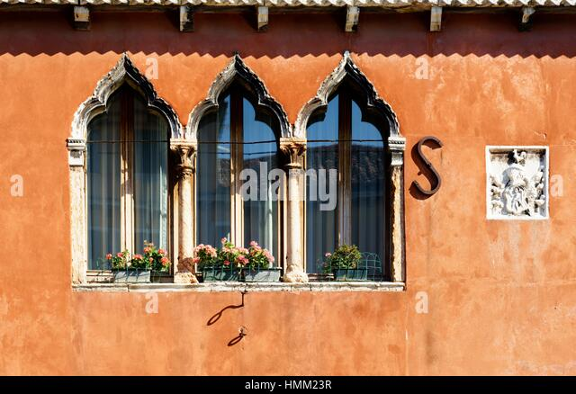 The facade of a historical building in old Venice Italy - Stock Image
