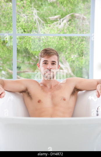 Man in Bathtub - Stock Image