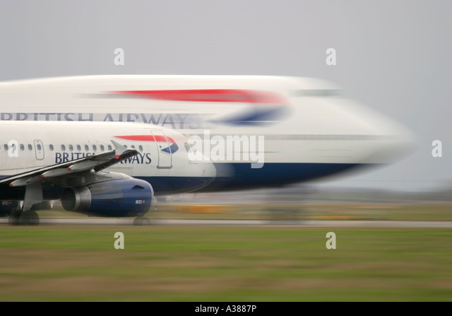 British Airways Airbus A320 and Boeing 747 in queue for departure at London Heathrow - Stock Image