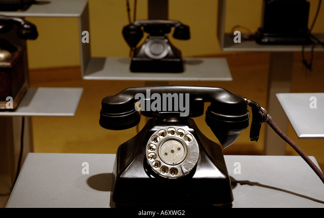 Vintage black rotary landline telephones - Stock Image