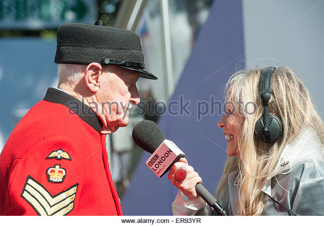 London UK 19th May 2015  RHS Chelsea Flower Show . A Chelsea Pensioner interviewed for Radio London by Jo Good. - Stock Image