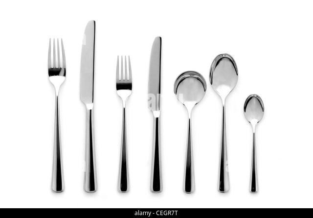 A still life shot of a modern silver stainless steel knifes, forks and spoons - Stock Image