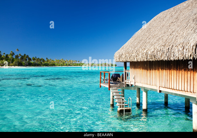 Over water bungalow with steps into amazing lagoon - Stock Image