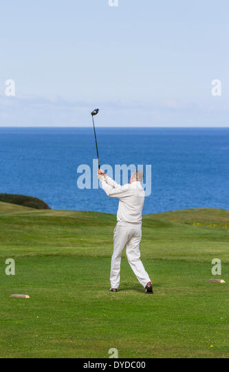 Teeing off on a seaside golf course. - Stock Image