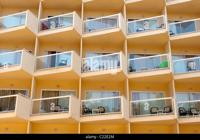 Hotel balconies building stock photos hotel balconies for Hotels with balconies