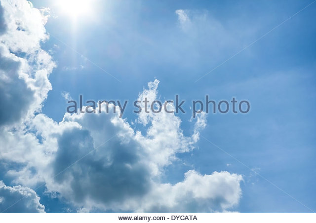 Beautiful blue sky with clouds and sun - Stock Image