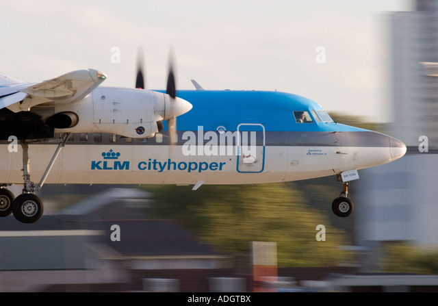 Close up of regional turboprop airplane Fokker 50 KLM about to land at London City Airport England UK - Stock Image