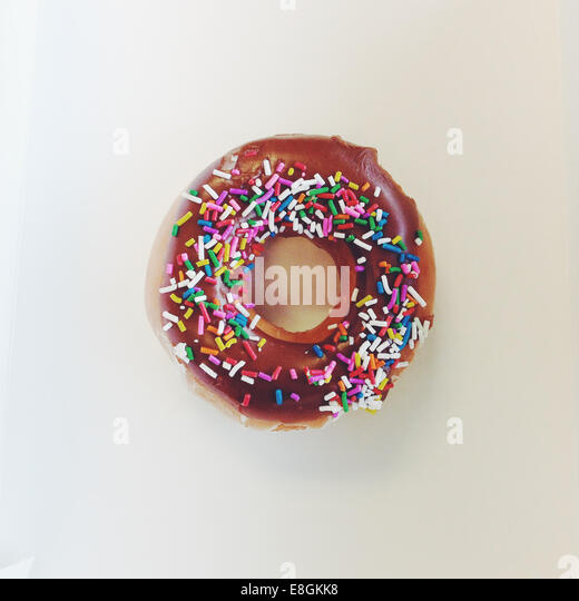 Doughnut with sprinkles - Stock Image