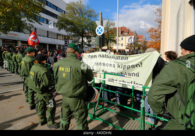 Anti riot units try to seperate violent left and right wing demonstrants - Baden Wuerttemberg, Germany, Europe. - Stock Image