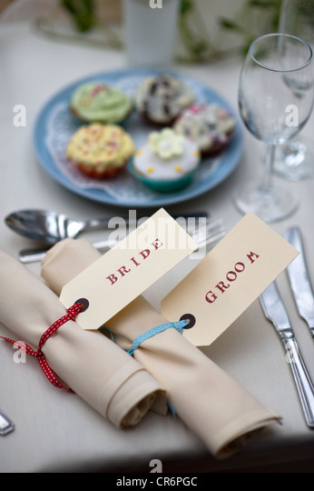 table setting for the bride and groom at a weddng meal - Stock Image