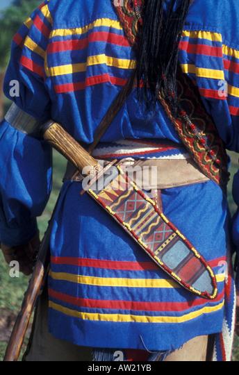 Florida Seminole Indian man traditional clothing large knife beaded knife case - Stock Image