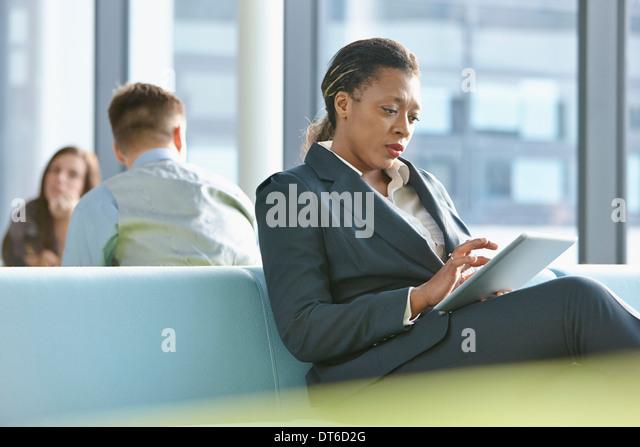 Businesswoman using digital tablet - Stock-Bilder