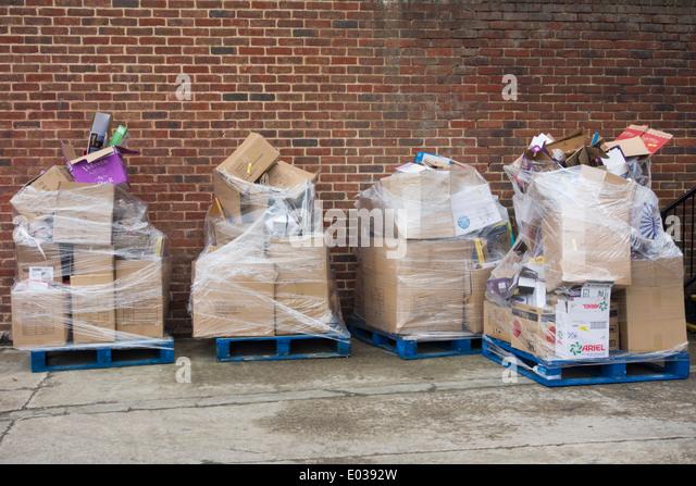 Pallets of empty cardboard boxes outside supermarket loading bay. UK - Stock Image