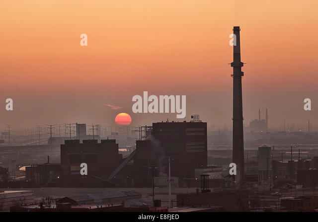 USA, Illinois, Cook County, Chicago, View of factory at sunset - Stock Image