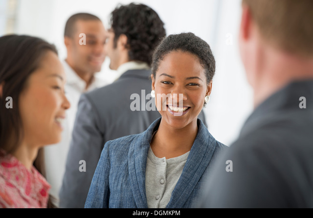 Business. A team of people, a multi ethnic group, men and women in a group. - Stock-Bilder