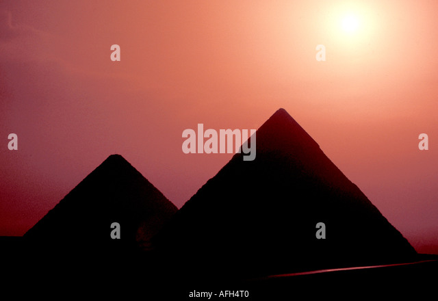 Egypt Gizaz two pyramids sunrise silhouette - Stock Image