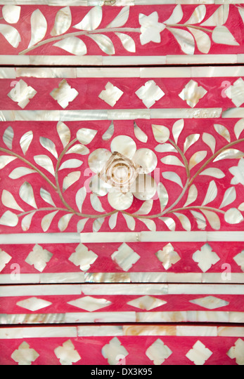 Marquetry detail of pink and white dresser drawer, full frame, close up - Stock Image