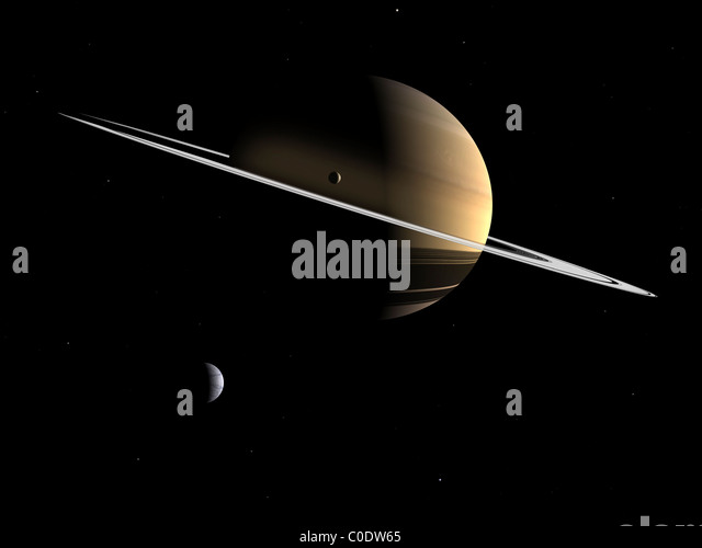 Artist's concept of Saturn and its moons Dione and Tethys. - Stock Image