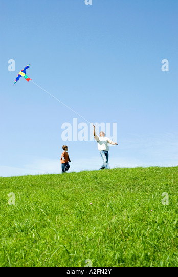 Father and son flying a kite - Stock Image