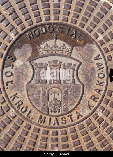 Coat of arms on a Iron Manhole Cocer, Krakow, Lesser Poland, Poland, Europe - Stock-Bilder