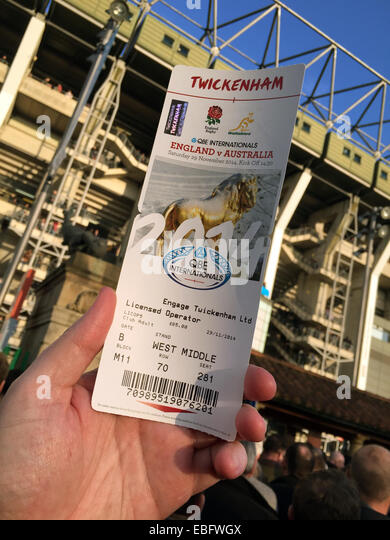 Holding an entrance ticket up at English Rugby at Twickenham, London, England, UK - Stock Image