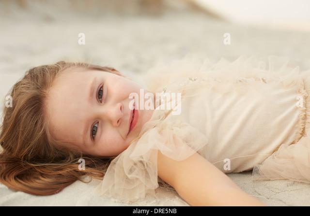 Happy little girl in princess dress - Stock Image