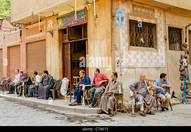 men smoking shisha in cairo old town - Stock Image