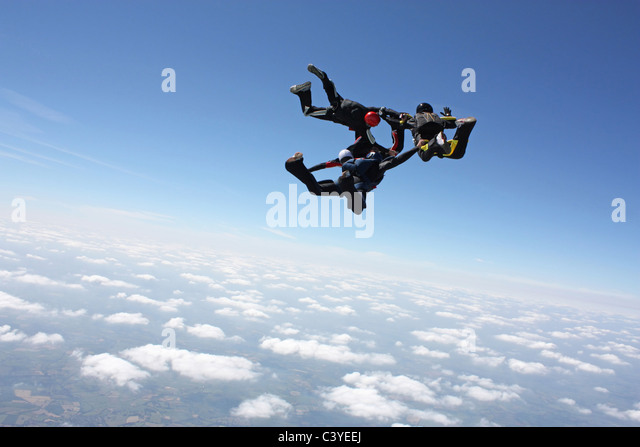 Four skydivers after they have exit an airplane - Stock Image